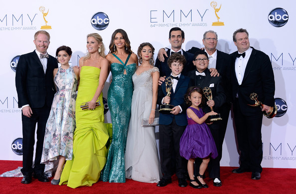 Julie Bowen (L-R) Actors Jesse Tyler Ferguson, Ariel Winter, Julie Bowen, Sofia Vergara, Sarah Hyland, Ty Burrell, Nolan Gould, Ed O'Neill, Rico Rodridgez, and Eric Stonestreet, with Aubrey Anderson-Emmons (front), pose in the press room during the 64th Annual Primetime Emmy Awards at Nokia Theatre L.A. Live on September 23, 2012 in Los Angeles, California.
