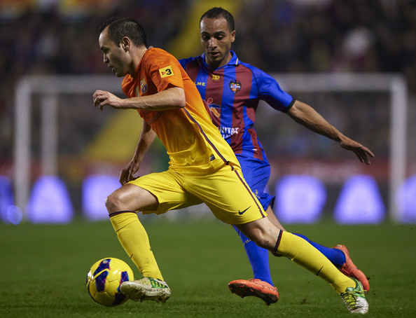 Nabil El Zhar (R) of Levante competes for the ball with Andres Iniesta of Barcelona during the la Liga match between Levante UD and FC Barcelona at Ciutat de Valencia on November 25, 2012 in Valencia, Spain.