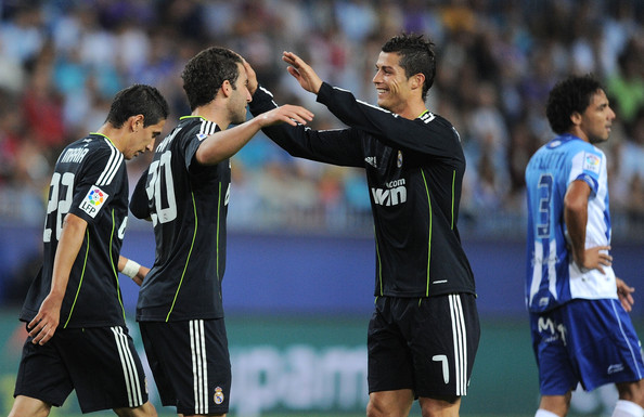 Cristiano Ronaldo (R) of Real Madrid celebrates with Gonzalo Higuain after Higuain scored Real's first goal during the La Liga match between Malaga and Real Madrid at La Rosaleda Stadium on October 16, 2010 in Malaga, Spain.