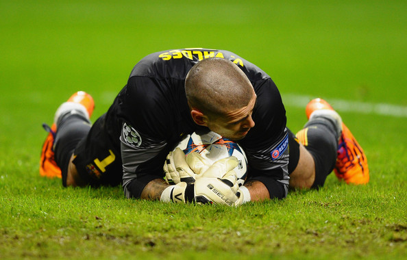 Victor Valdes of Barcelona makes a save during the UEFA Champions League Round of 16 first leg match between Manchester City and Barcelona at the Etihad Stadium on February 18, 2014 in Manchester, England.