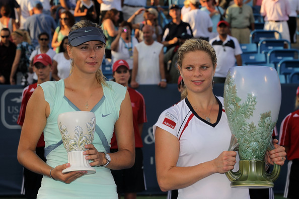 Maria Sharapova Kim Clijsters (R) of Belgium and Maria Sharapova of Russia poses with their individual trophies during the singles final match on day seven of the Western & Southern Financial Group Women's Open on August 15, 2010 at the Lindner Family Tennis Center in Cincinnati, Ohio.