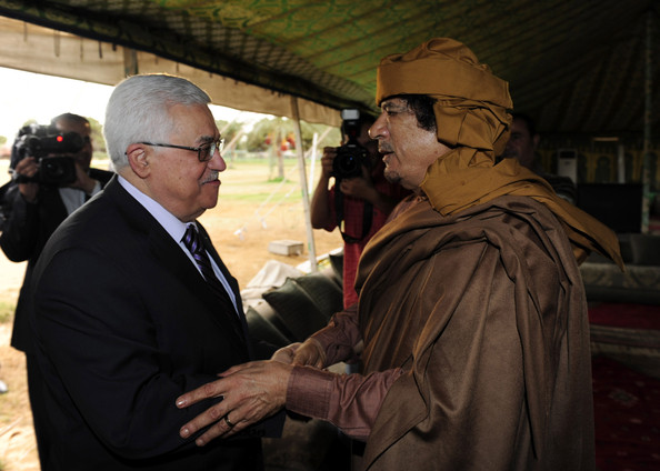 In this handout image provided by the Palestinian Press Office (PPO), Palestinian President Mahmoud Abbas (C) is greeted by Libyan leader Muammar Gaddafi (R) on September 4, 2010 in Libya, Tripoli. Abbas is in Libya following a trip to the U.S. for Mideast peace talks in which he met in a State Department room alone with Israeli Prime Minister Benjamin Netanyahu.