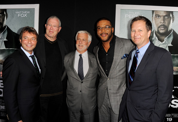 """(L-R) Patrick Wachsberger, co-chairman, Lionsgate, Michael Paseornek, president of motion picture production and development, Lionsgate, Rob Friedman, co-chairman, Lionsgate, actor Tyler Perry and Michael Burns, vice-chairman, Lionsgate arrive at the premiere of Summit Entertainment's """"Alex Cross"""" at the Arclight Theater on October 15, 2012 in Los Angeles, California."""