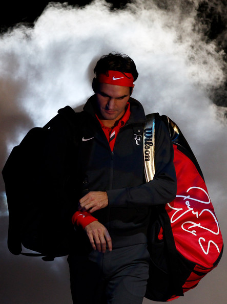 Roger Federer Roger Federer of Switzerland arrives on court before his men's singles first round match against David Ferrer of Spain during the Barclays ATP World Tour Finals at O2 Arena on November 21, 2010 in London, England.