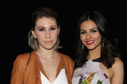 Actors Zosia Mamet and Victoria Justice pose backstage at the Rebecca Minkoff fashion show with TRESemme during Mercedes-Benz Fashion Week Fall 2015 at The Pavilion at Lincoln Center on February 13, 2015 in New York City.