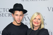 "Nick Jonas (L) and Victoria's Secret CEO Sharen Turney attend Russell James' ""Angel"" book launch hosted by Victoria's Secret on September 10, 2014 in New York City."