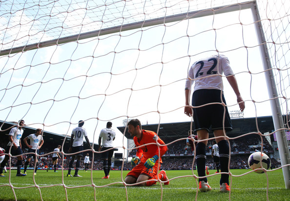 (L-R) Dejected Goalkeeper Hugo Lloris of Spurs and Gylfi Sigurdsson of Spurs react after failing to stop the ball going into the net as teamate Harry Kane (2nd L) of Spurs scores an own goal during the Barclays Premier League match between West Ham United and Tottenham Hotspur at Boleyn Ground on May 3, 2014 in London, England.