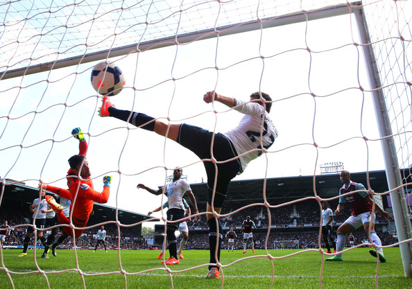 (L-R) Goalkeeper Hugo Lloris of Spurs and Gylfi Sigurdsson of Spurs fail to stop the ball going into the net as teamateHarry Kane of Spurs scores an own goal during the Barclays Premier League match between West Ham United and Tottenham Hotspur at Boleyn Ground on May 3, 2014 in London, England.