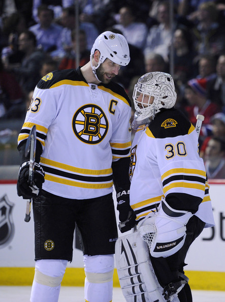 Zdeno Chara #33 and Tim Thomas #30 of the Boston Bruins discuss strategy before a faceoff in Game Six of the Eastern Conference Quarterfinals against the Montreal Canadiens during the 2011 NHL Stanley Cup Playoffs at the Bell Centre on April 26, 2011 in Montreal, Canada.