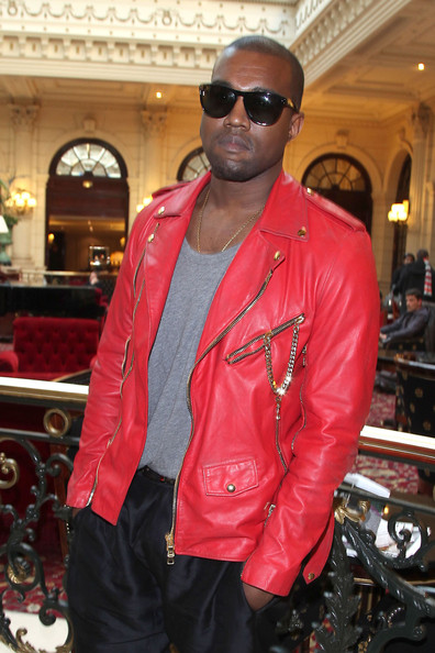 Kanye West Kanye West, wearing a Michael Jackson-esque red leather jacket, arrives at the Balmain Fashion Show, during Paris Fashion Week.