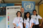 UN Youth volunteers taking a photo with replica of UN Secretary General Ban Ki-Moon after collecting votes from the public for MY World global survey.