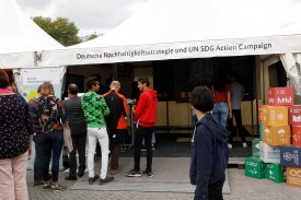 Visitors explore the CANON Young People Program SDG Stories at the German Federal Government Open doors day