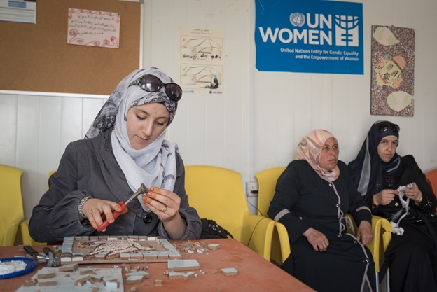 Alaa in a mosaic workshop in UN Women's women center (Oasis) in Zaatari Refugee Camp. Photo: UN Women/Christopher Herwig