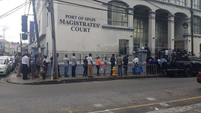 The line stretched around the Port of Spain Magistrates Court, this morning, as COVID-19 screening protocols were implemented by Judiciary staff.