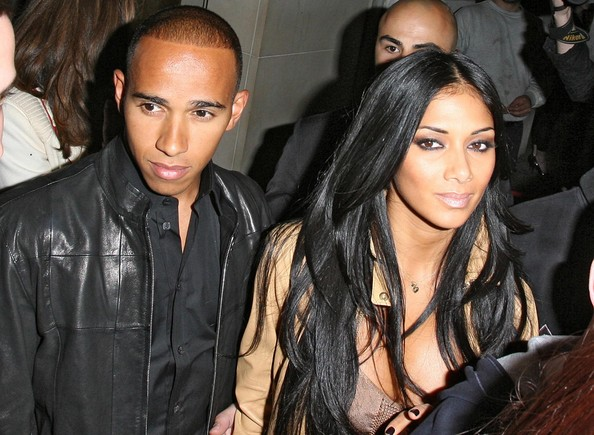 F1 star Lewis Hamilton with girlfriend Nicole Scherzinger and her bandmates from the Pussycat Dolls, Kimberly Wyatt, Ashley Roberts and Jessica Sutta on a nightout at the Nobu Berkeley restaurant in London. On leaving the bands security became difficult causing a mass scrum....