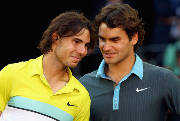 Rafael Nadal Roger Federer of Switzerland (R) and Rafael Nadal of Spain share a moment during the prize giving ceremony after the mens final during the Madrid Open tennis tournament at the Caja Magica on May 17, 2009 in Madrid, Spain.  (Photo by Clive Brunskill/Getty Images) *** Local Caption *** Rafael Nadal;Roger Federer
