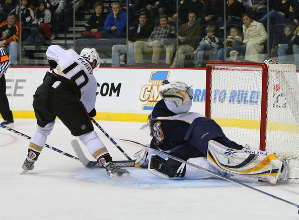 Pekka Rinne #35 of the Nashville Predators is beaten by Corey Perry #10 of the Anaheim Ducks in the first period on February 5, 2009 at the Sommet Center in Nashville, Tennessee.  (Photo by Bruce Bennett/Getty Images) *** Local Caption *** Corey Perry;Pekka Rinne