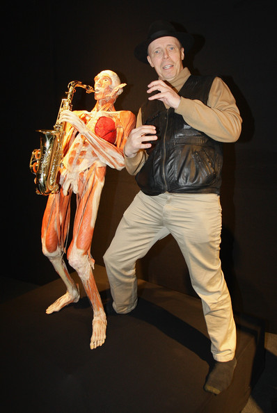 Gunther von Hagen poses with a saxophone musician exhibit at his 'Body Worlds' exhibition at Postbahnhof on May 6, 2009 in Berlin, Germany. The exhibit opens to the public on May 7.  (Photo by Andreas Rentz/Getty Images) *** Local Caption *** Gunther von Hagen