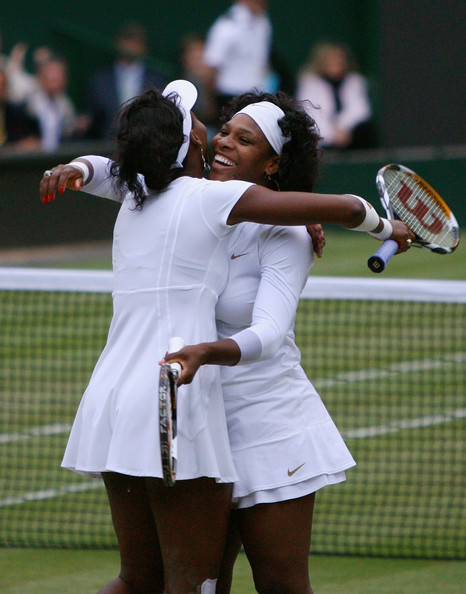 Serena Williams Venus Williams of United States and Serena Williams of United States celebrate match point and winning the women's doubles Final match against Lisa Raymond of United States and Samantha Stosur of Australia on day twelve of the Wimbledon Lawn Tennis Championships at the All England Lawn Tennis and Croquet Club on July 5, 2008 in London, England.