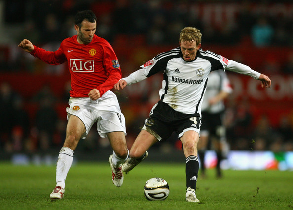 Paul Green Ryan Giggs of Manchester United competes for the ball with Paul Green of Derby County during the Carling Cup Semi Final 2nd Leg match between Manchester United and Derby County at Old Trafford on January 20, 2009 in Manchester, England. (Photo by Alex Livesey/Getty Images) *** Local Caption *** Paul Green;Ryan Giggs
