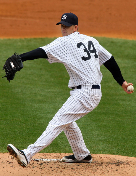 A.J. Burnett #34 of the New York Yankees pitches against the Minnesota Twins on May 17, 2009 at Yankee Stadium in the Bronx borough of New York City.  (Photo by Jim McIsaac/Getty Images) *** Local Caption *** A.J. Burnett