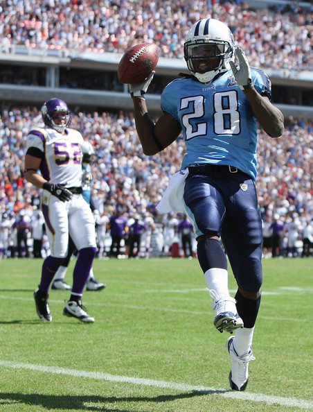 Running back Chris Johnson #28 of the Tennessee Titans celebrates as he scores a touchdown past linebacker Chad Greenway #52 of the Minnesota Vikings at LP Field on September 28, 2008 in Nashville, Tennessee. The Titans defeated the Vikings 30-17.