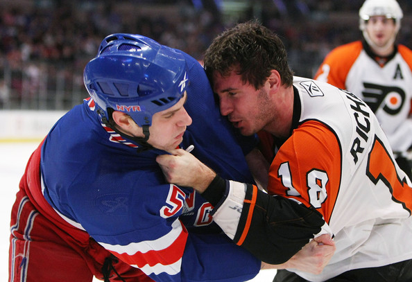 Mike Richards #18 of the Philadelphia Flyers and Dan Girardi #5 of the New York Rangers fight on March 15, 2009 at Madison Square Garden in New York City.The Rangers defeated the Flyers 4-1. (Photo by Bruce Bennett/Getty Images) *** Local Caption *** Mike Richards;Dan Girardi