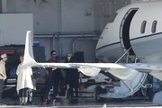 """Singer Justin Timberlake and his pregnant wife Jessica Biel look to be spending New Years outside of Los Angeles, as they're seen boarding a private jet with family on December 28, 2014 in Los Angeles, California. Justin spoiled Jessica this Christmas by doing the holiday baking- he posted a picture of himself draped over a stand mixer and captioned it, """"Just so y'all know who was doing the baking today… Yeah, buddy! Your boy got it in! Merry Christmas and stuff…"""""""