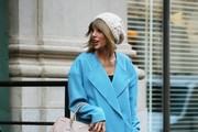 "Pop singer Taylor Swift is seen leaving her home in New York City, New York on December 11, 2014. Taylor and gal pal Kendall Jenner recently stopped by model Gigi Hadid's NYC apartment to help her decorate for the holiday season. Gigi posted a video on her Instagram page which read: ""First day of snow that sticks means TIME TO PUT UP LIGHTS @emmasittig !!!! Big hugs and candy-cane cookies to our helper-elves @kendalljenner &@taylorswift."""