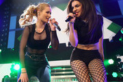 Singers Iggy Azalea (L) and Charli XCX perform onstage during 103.5 KISS FM's Jingle Ball 2014 at Allstate Arena on December 18, 2014 in Chicago, Illinois.