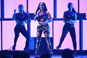 Recording artist Nicki Minaj (center) performs onstage during the 2014 iHeartRadio Music Festival at the MGM Grand Garden Arena on September 19, 2014 in Las Vegas, Nevada.