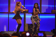 Singers Ariana Grande (L) and Nicki Minaj perform onstage during the 2014 iHeartRadio Music Festival at the MGM Grand Garden Arena on September 19, 2014 in Las Vegas, Nevada.