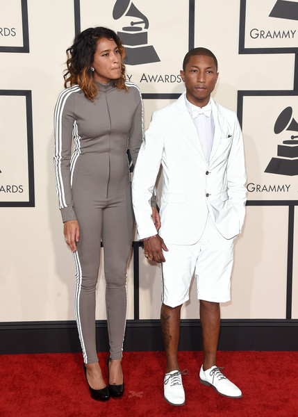 Helen Lasichanh (L) and recording artist Pharrell Williams attend The 57th Annual GRAMMY Awards at the STAPLES Center on February 8, 2015 in Los Angeles, California.