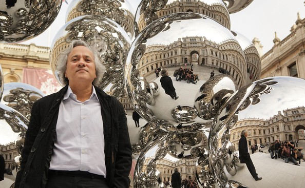 Anish Kapoor Artist Anish Kapoor stands with his new sculpture entitled  'Tall Tree and the Eye' in the courtyard of The Royal Academy on September 22, 2009 in London. The Anish Kapoor exhibition runs from September 26 to December 11, 2009 at The Royal Academy.