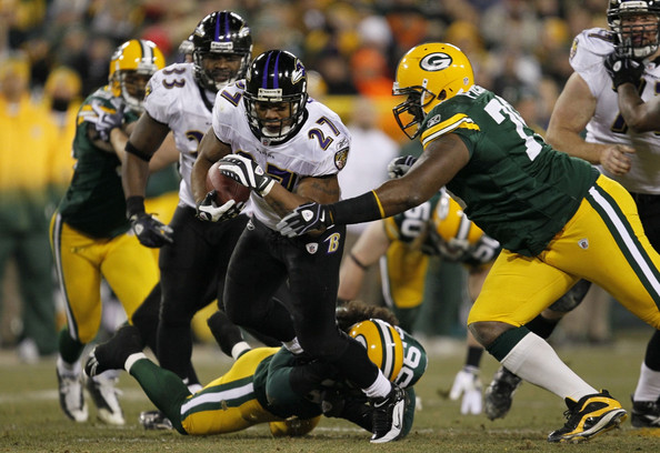 Ray Rice Ray Rice #27 of the Baltimore Ravens runs the ball in the first half against Ryan Pickett #79 of the Green Bay Packers at Lambeau Field on December 7, 2009 in Green Bay, Wisconsin.