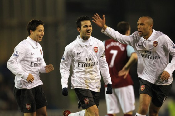 Cesc Fabregas of Arsenal celebrates with Samir Nasri and Mikael Silvestre after scoring the opening goal during the Barclays Premier League match between Burnley and Arsenal at Turf Moor on December 16, 2009 in Burnley, England.