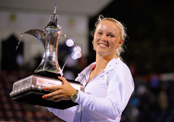 Caroline Wozniacki Caroline Wozniacki of Denmark celebrates beating Svetlana Kuznetsova of Russia and winning the final of the Dubai Duty Free Tennis Championship at the Dubai Tennis Stadium on February 20, 2011 in Dubai, United Arab Emirates.