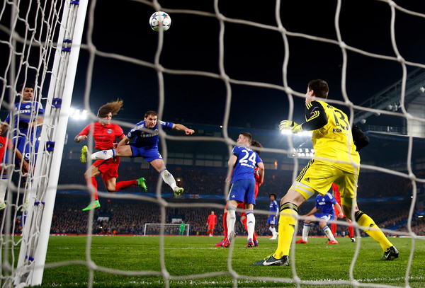 David Luiz of PSG rises above Branislav Ivanovic of Chelsea to score a gol past goalkeeper Thibaut Courtois of Chelsea to level the scores at 1-1 during the UEFA Champions League Round of 16, second leg match between Chelsea and Paris Saint-Germain at Stamford Bridge on March 11, 2015 in London, England.