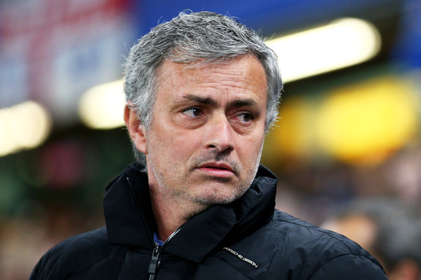 Jose Mourinho the manager of Chelsea looks on prior to kickoff during the UEFA Champions League Round of 16, second leg match between Chelsea and Paris Saint-Germain at Stamford Bridge on March 11, 2015 in London, England.