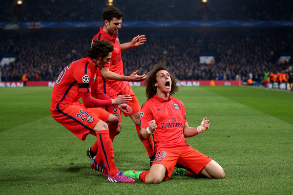 David Luiz (R) of PSG celebrates after scoring a goal to level the scores at 1-1 during the UEFA Champions League Round of 16, second leg match between Chelsea and Paris Saint-Germain at Stamford Bridge on March 11, 2015 in London, England.