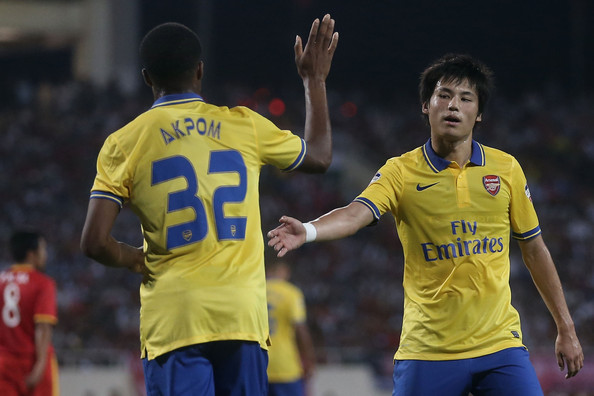 Chuba Akpom Chuba Akpom #32 of Arsenal is congratulated by team mate Ryo Miyaichi #31 after scoring a goal against Vietnam during the international friendly match between Vietnam and Arsenal FC at My Dinh National Stadium on July 17, 2013 in Hanoi, Vietnam.