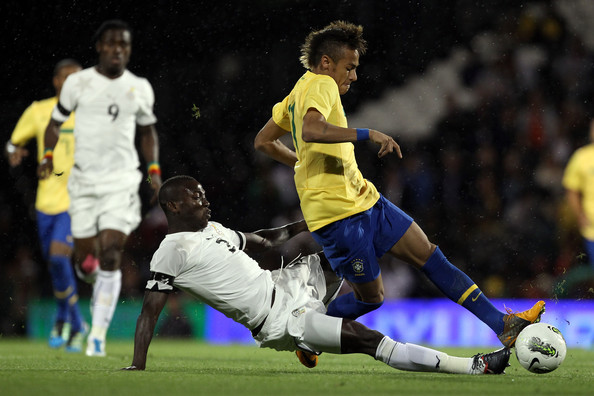 Daniel Opare Neymar of Brazil is challenged by Daniel Opare of Ghana during the International friendly match between Brazil and Ghana at Craven Cottage on September 5, 2011 in London, England.
