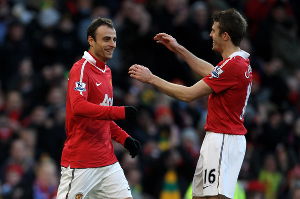Dimitar Berbatov Dimitar Berbatov (L) of Manchester United is congratulated by team mate Michael Carrick after scoring the opening goal during the Barclays Premier League match between Manchester United and Blackburn Rovers at Old Trafford on November 27, 2010 in Manchester, England.