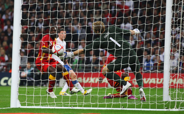 Goalkeeper Joe Hart of England saves a shot from Dominic Adiyiah of Ghana during the international friendly match between England and Ghana at Wembley Stadium on March 29, 2011 in London, England.