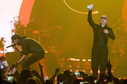 Enrique Iglesias and Pitbull perform onstage at Allstate Arena on February 20, 2015 in Rosemont, Illinois.