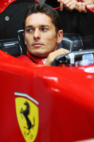 Giancarlo Fisichella New Ferrari driver Giancarlo Fisichella of Italy familiarises himself with his car in the team garage during previews to the Italian Formula One Grand Prix at the Autodromo Nazionale di Monza on September 10, 2008 in Monza, Italy.