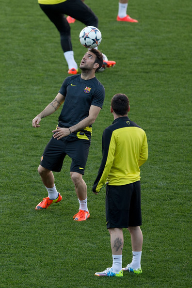Cesc Fabregas (L) of FC Barcelona controls the ball as his teammate Lionel Messi (R) looks on during a training session the day before the UEFA Champions League Quarter-final match between Atletico de Madrid and FC Barcelona at Vicente Calderon Stadium on April 8, 2014 in Madrid, Spain.