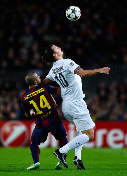 Zlatan Ibraimovic of Paris Saint-Germain FC competes for the ball with Javier Mascherano of FC Barcelona during prior to the UEFA Champions League group F match between FC Barcelona and Paris Saint-Germanin FC at Camp Nou Stadium on December 10, 2014 in Barcelona, Spain.