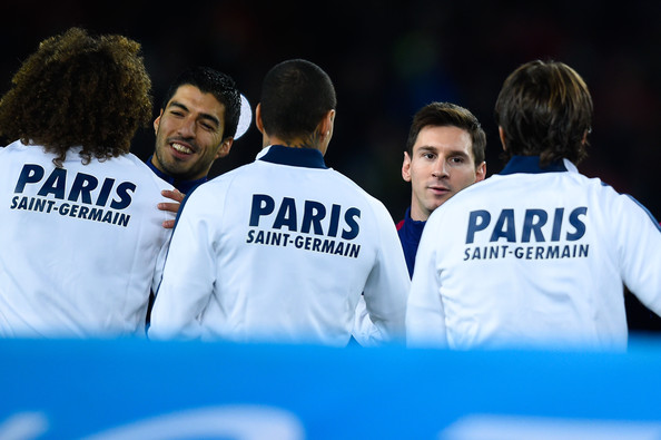 Luis Suarez (L) and Lionel Messi of FC Barcelona shake hands with Paris Saint-Germain FC players prior to the UEFA Champions League group F match between FC Barcelona and Paris Saint-Germanin FC at Camp Nou Stadium on December 10, 2014 in Barcelona, Spain.