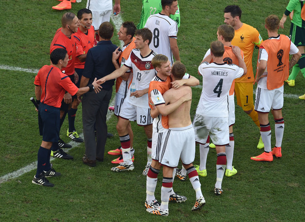 Andre Schuerrle and Per Mertesacker of Germany hug after a 1-0 victory over France in the 2014 FIFA World Cup Brazil Quarter Final match between France and Germany at Maracana on July 4, 2014 in Rio de Janeiro, Brazil.